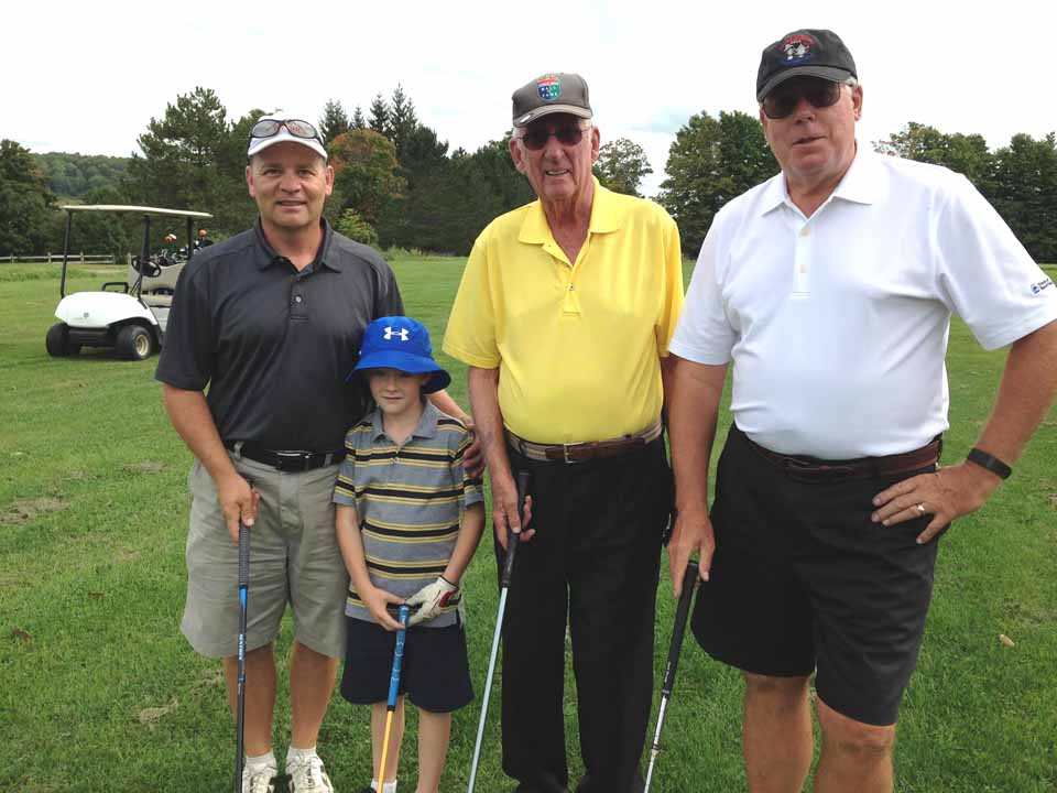 A last-minute substitute, 8-year-old Mason Campbell helped take his team, from left, dad Rodney, Earl Hayford and Bob Schlather, to Captain & Crew high scores. (Ellen Tillapaugh Kuch photo)