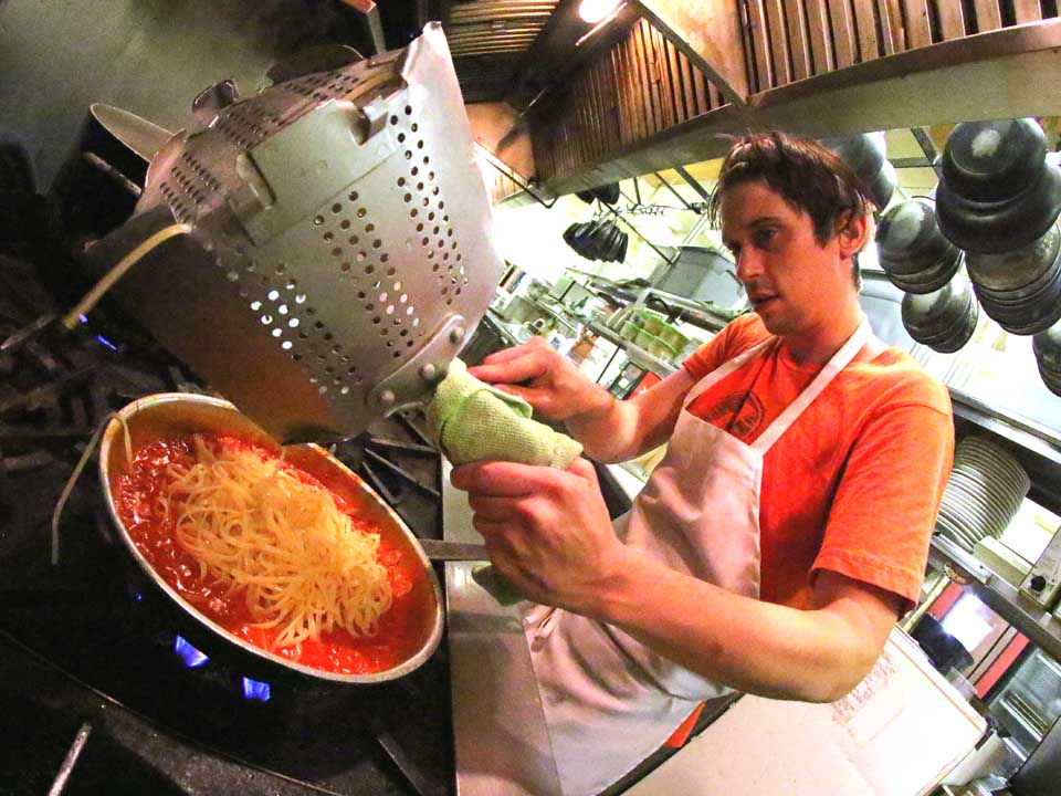 Laurens' Jon Keane prepares the first batch of bucatini all'Amatriciana Tuesday afternoon at Oneonta's Stella Luna.  (Ian Austin/AllOTSEGO.com)