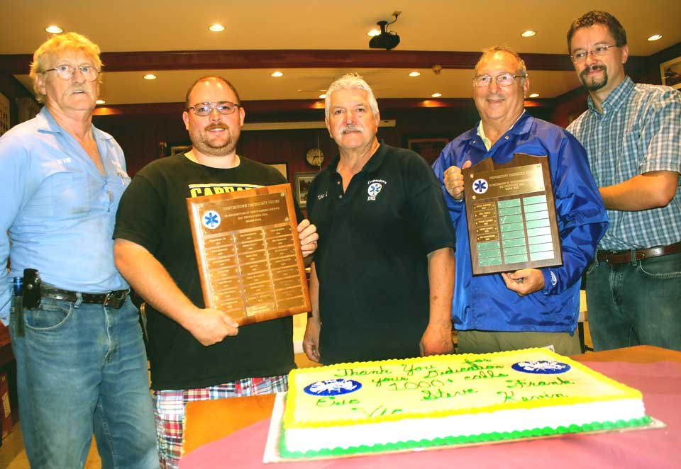 "The Cooperstown Volunteer Fire Department last evening honored five members who have responded to more than 1,000 calls for the Cooperstown Emergency Squad.  From left are, Kevin ""Kap"" Preston, Steve Clancy, Vic Carrascoso, Frank Capozza and Eric Pierce.   Steve and Frank also hold the plaques bearing the names of all members who have surpassed the 1,000-call mark.  Preston, Clancy, Capozza and Pierce are also drivers/firefighters.  (Jim Kevlin/AllOTSEGO.com)"