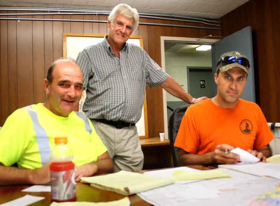 His first day of his permanent appointment, Will Mason, the county's new highway superintendent, plans salting and plowing programs with Rich Brimmer, left, and Kevin Hoose. (AllOTSEGO.com)