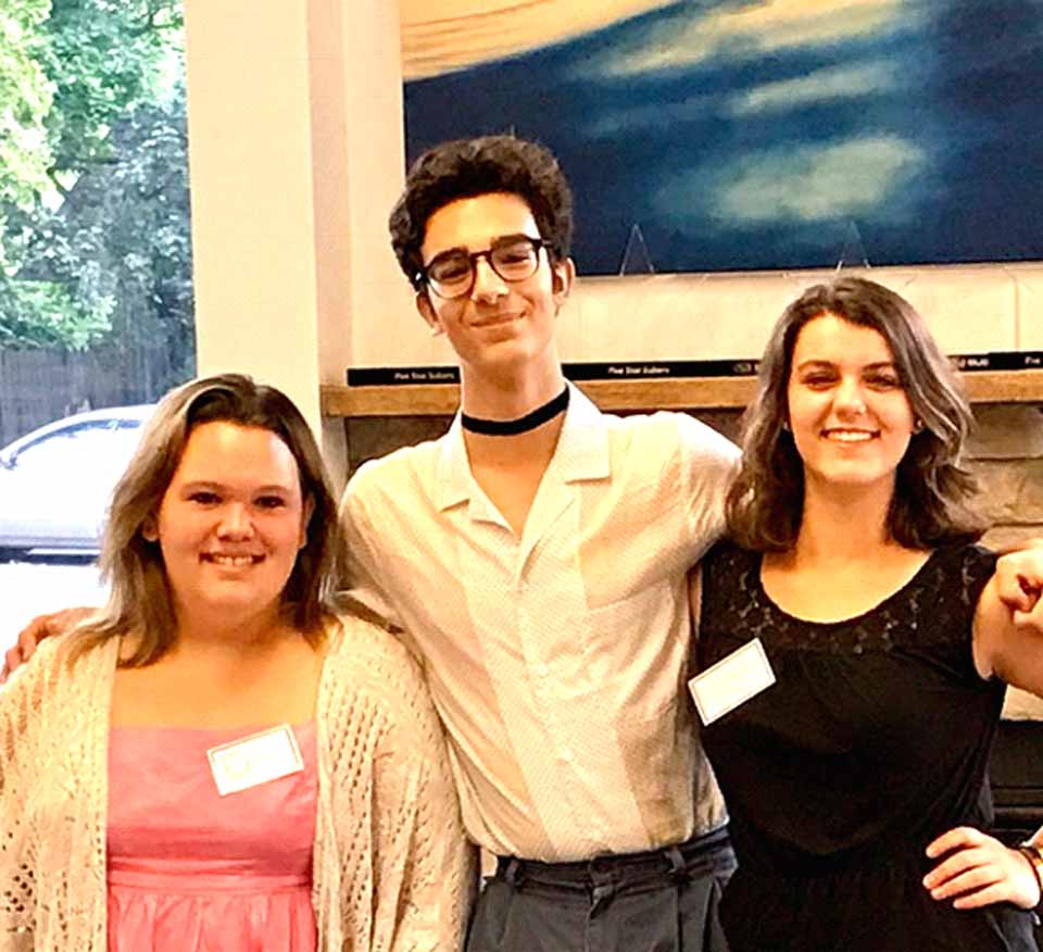 Winning artists from LEAF's art show over the summer were celebrated anew this afternoon at an opening reception for their works at Five Star Subaru in Oneonta. From right are Eva Race, first, Massimo Avanzato, third, and Cassondra Garufi, second. (Tara Barnwell/AllOTSEGO.com)