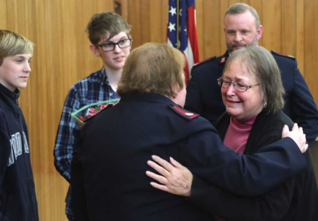 """Sharon Haines embraces Maj. Sharon Hartford, commander of the Oneonta post, after she was surprised with the """"Others"""" Award for 42 years of service. (Ian Austin/AllOTSEGO.com)"""