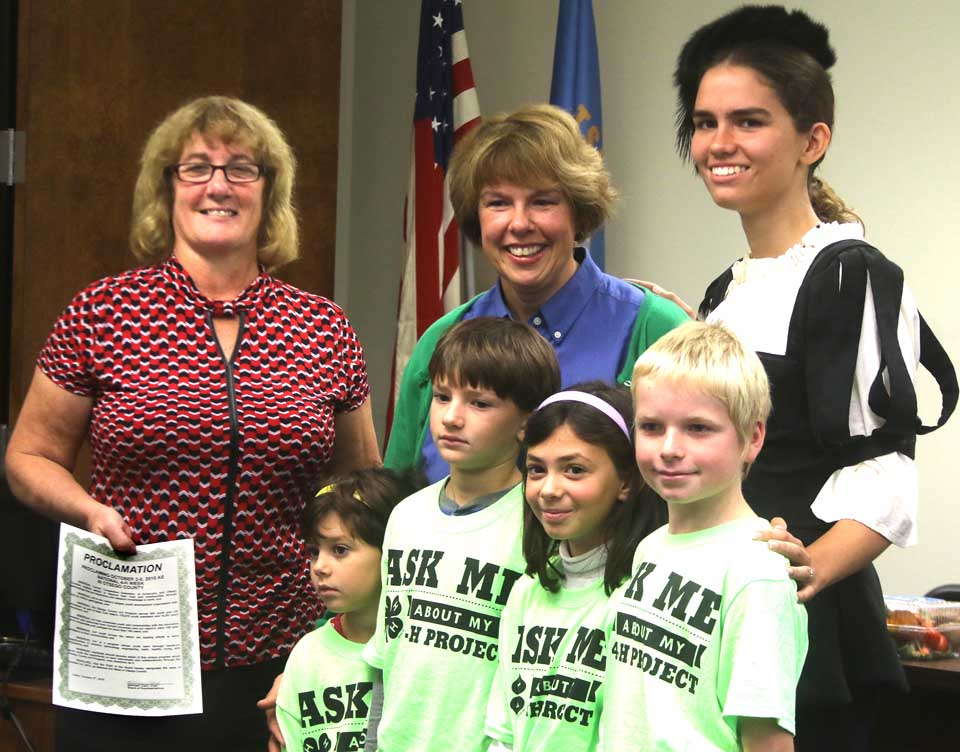County Board Chair Kathy Clark, R-Otego, presents a proclamation to 4-H Club representatives designating 4-H Week in Otsego County.   The youngsters