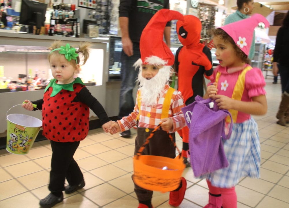Over 500 children and their families packed the halls of the Southside Mall this afternoon during the annual Mall-O-Ween event. Here, Harlow Foster, Nyah Stanley and her sister Draya, dressed as two gnomes and a strawberry, all of Oneonta, march down the halls in search of holiday treats. (Ian Austin/AllOTSEGO.com)