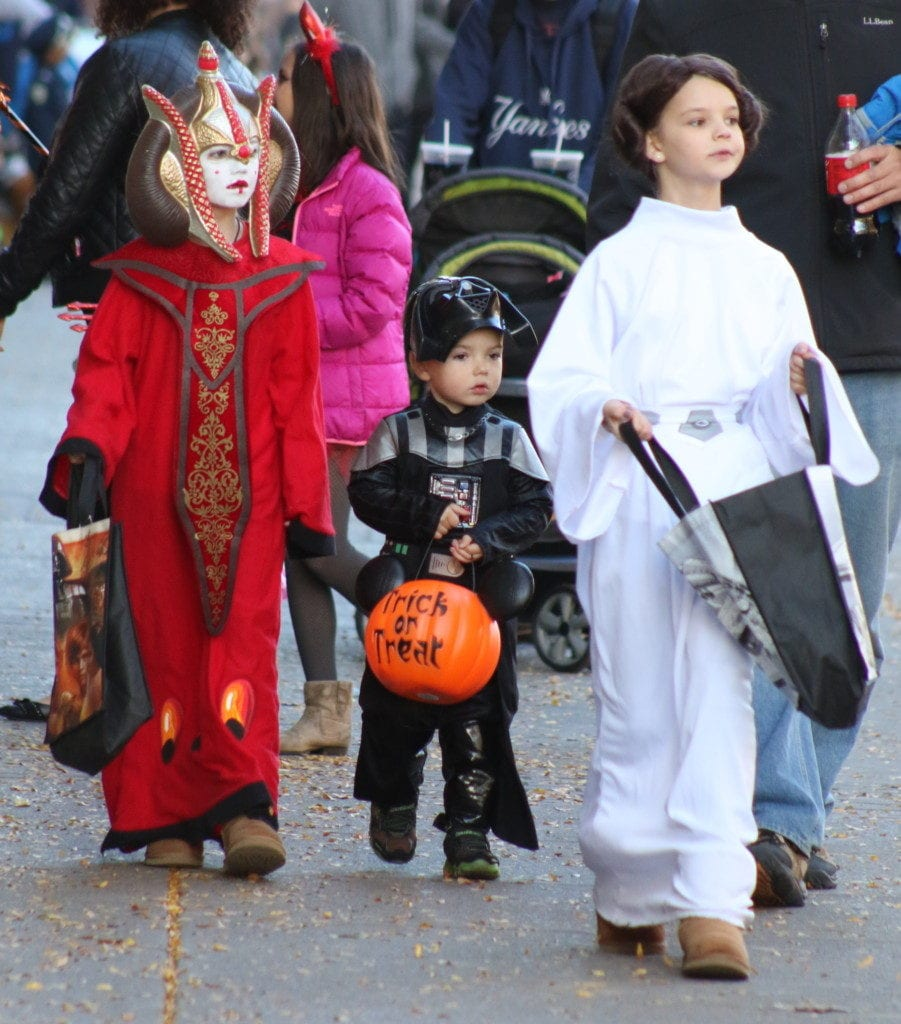 Princess Padme (Shayla Truesdel), Darth Vader Declan Truesdell), and Princess Leia (Brigha Truesdell) were able to set aside their galactic differences for some trick-or-treating in downtown Oneonta this afternoon before the parade. (Ian Austin/AllOTSEGO.com)