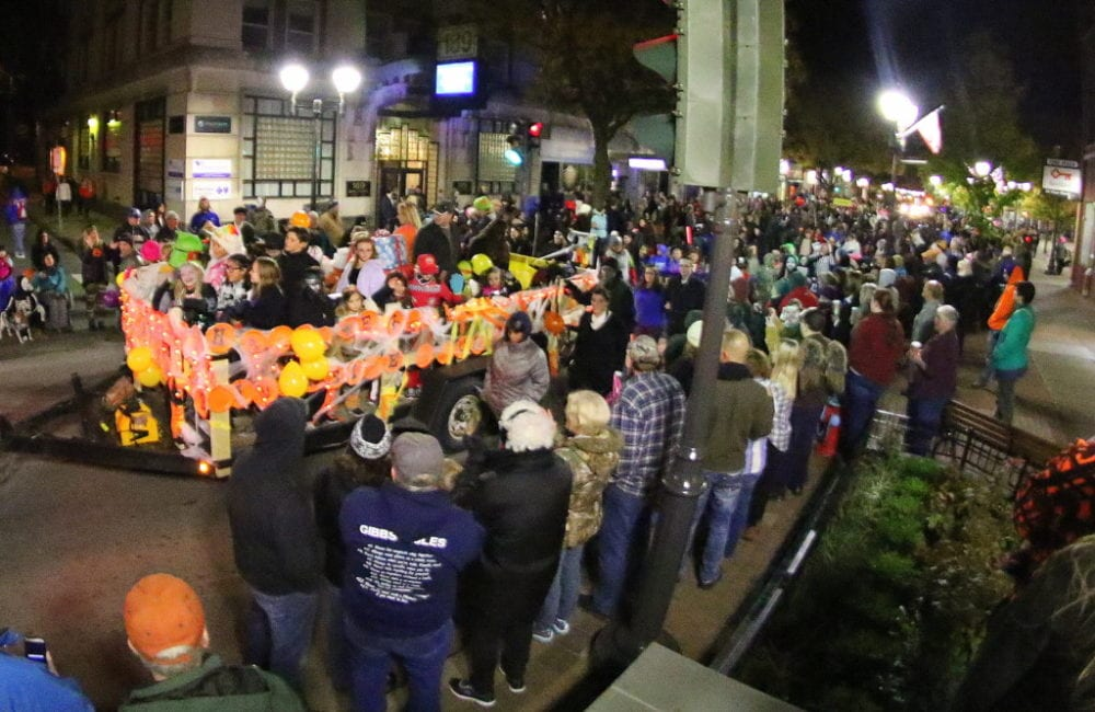 You'd be hard pressed to figure out if there were more people in the parade or watching it! Spectators of the annual Oneonta Halloween Parade cheer and wave as the Riverside School float makes it's way through the heart of downtown this evening. (Ian Austin/AllOTSEGO.com)