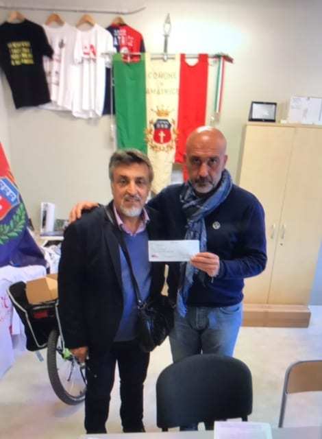 Vinne Avanzato delivered a check for $3,000 from the sale of Bucatini All'Amatraciana to Amatrice Mayor Sergio Pirrozi