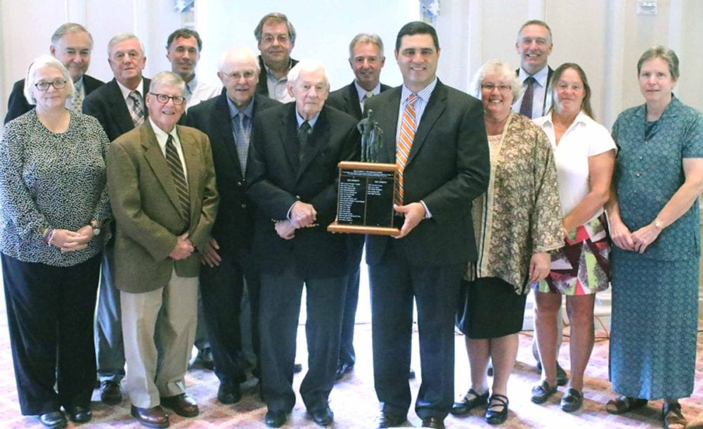 Mike Perrino, recipient of the Clark Sports Center's 23rd annual Fetterman Award, stands with previous recipients following the recognition ceremony at the Otesaga Hotel this afternoon. From left, Pat Hazard, '01, Ted Kantorowski, '95, Jack Vineyard, '94, Paul Lambert, '10, Perrino, Connie Herzig, '08, Brenda Wedderspoon-Gay, '09, Brenda Jaeger, '12, Ted Spencer, '04, Sharky Nagelschmidt, '02, Bobby Hall, '15, Ed Hazard, '01, Bob Snyder, '07 and Dave Bliss, '13. (Ian Austin/AllOTSEGO.com)