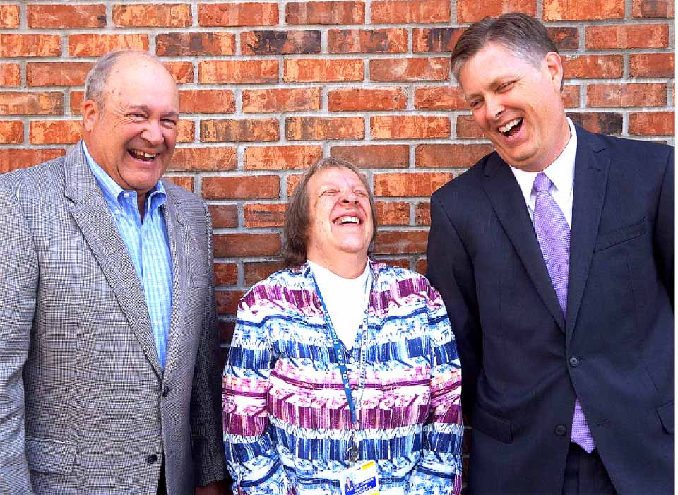 Dorothy Johnson, the longest serving Fox employee, shares a laugh with Fox President Jeff Joyner, right, and Dan Robinson, who chairs the board of directors.  (Justine Johnson photo)
