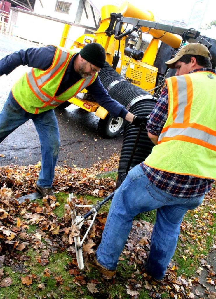 There is still some color in Otsego County's trees, but high winds and pounding rain over the weekend certainly pushed the foliage past peak. A sign of the season in Cooperstown this morning was Russ Adams, left, and Dan Crippen, vacuuming leaves along Railroad Avenue and throughout the village. (Jim Kevlin/AllOTSEGO.com)