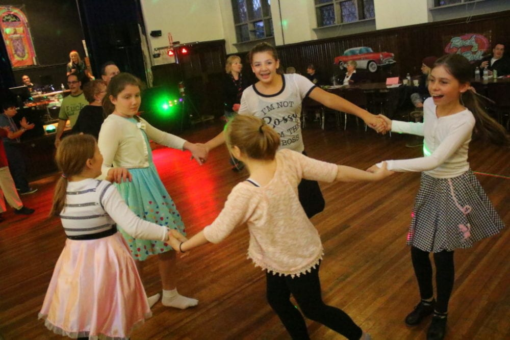Oneonta's Tiffany Gardner, Casey Daum, Isabella Gracias, Emily Morell and Emily Thompson dance the night away at the final Sock Hop of the year at the First United Methodist Church this evening. Songs of yesteryear were alive and well for 123 attendees who raised over $2500 at the event, making it the most successful Sock Hop to date. Proceeds go to First United Methodist and Hospice. (Ian Austin/AllOTSEGO.com)