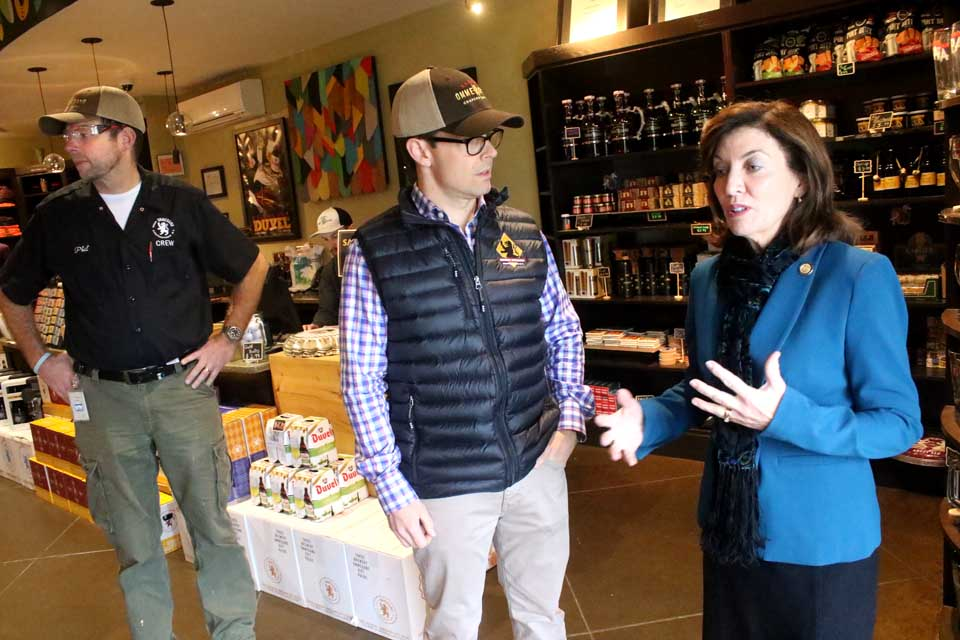 Lt. Gov. Kathy Hochul discusses Ommegang's plans and products with brewery President Doug Campbell during a noontime stop at the Town of Middlefield plant this morning, part of an Upstate swings that would take her to Buffalo by day's end. At left is Phil Leinhart, Ommegang's internationally recognized brewer. Campbell gave Hochul a tour of the brewing and bottling operation, including a discussing of the new malt house, ending up in the gift shop. (Jim Kevlin/AllOTSEGO.com)