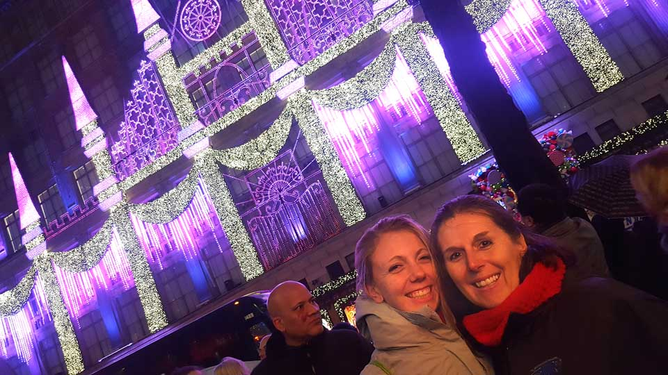 "Michaela Buzzy and Mom Heidi Hofbauer Buzzy waiting in line watching the Saks 5th Avenue light show. ""It looks huge! It looks great! I am so glad the tree made the long trip!"" said Heidi"