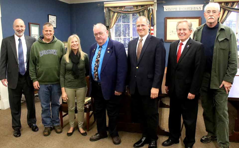 In the Cooperstown Village Board chambers a few minutes ago, Assemblyman Bill Magee, D-Nelson, announced he had obtained $2 million in state funding toward $7.5 million in upgrades required at the half-century-old waste-water treatment plan on the Susquehanna at the south end of the village. Flanking the assemblyman are, from left,