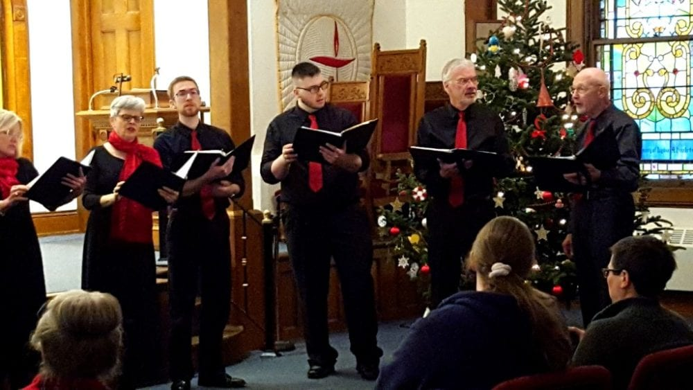 """Members of the Catskill Chamber Singers Emma Kirsch, Sarah Patterson, Ian Lamont, Mike Moran, Gary Lamont and Paul Sheele singing """"Deck The Halls"""" during their holiday concert Christmas in the Catskills: Songs of the Season, preformed this afternoon at the Unitarian Universalist Church in Oneonta. The event featured a dozen singers delighting audiences with many Christmas song staples to bring out your Christmas spirit! (Ian Austin/AllOTSEGO.com)"""