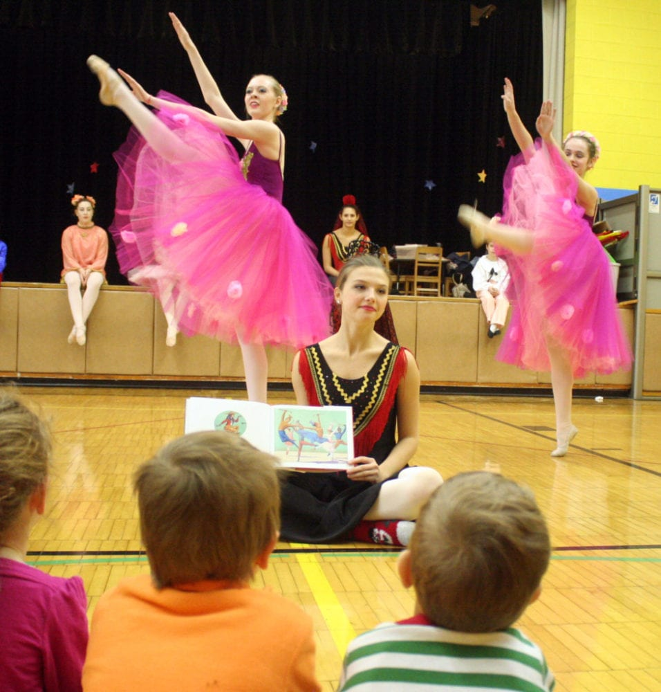 "The children of the YMCA's Universal Pre-K program at Jump Start got a special treat on Thursday afternoon as members of the Fokine Ballet Studio came in and preformed dances from their 29th annual production of The Nutcracker, which opens at Goodrich Theater this weekend. When the school show this afternoon sold out, the company decided that they would bring the performance to those who could not go! Here, Gabriella Basdekis reads the storybook of The Nutcracker, while Hannah Reynolds and Shiobhan Higgins preform ""Waltz Of The Flowers"". The show runs Friday at 7pm, Saturday at 1pm and Sunday at 7pm. Tickets are still available, but going quickly. (Ian Austin/AllOTSEGO.com)"