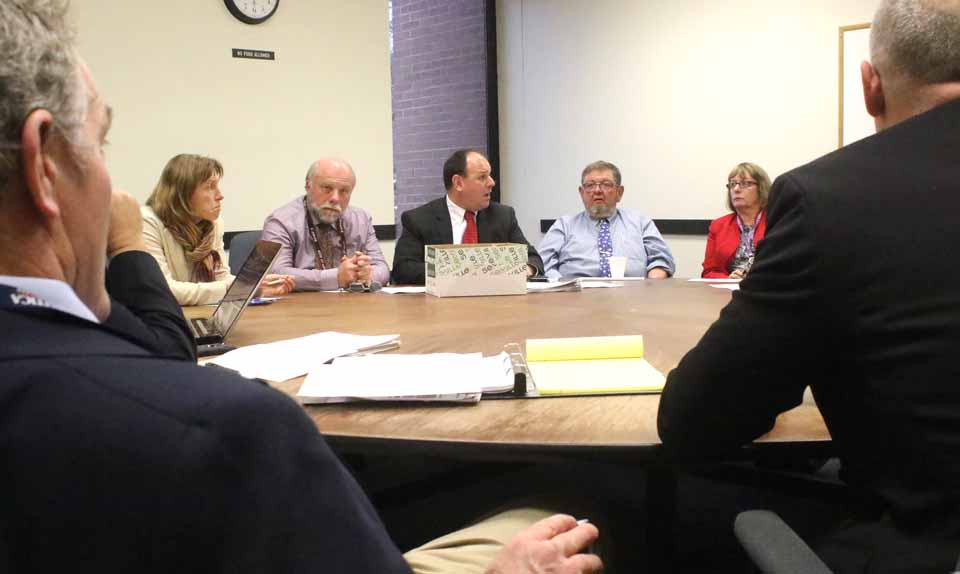 """Onondaga County's purchasing director, Andrew Trombley, center, is flanked by county reps, from left, Meg Kennedy, Dan Wilber, Keith McCarty and Kathy Clark at this morning's """"committee of the whole"""" meeting. (Jim Kevlin/AllOTSEGO.com)"""