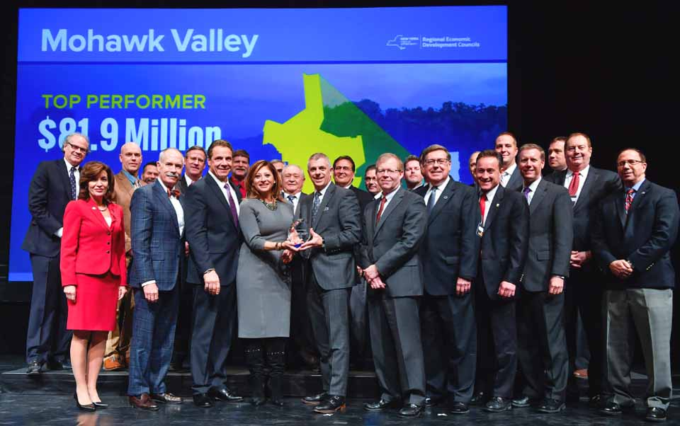 Governor Cuomo appears in photo for Mohawk Valley contingent that includes Otsego County this afternoon at The Egg in Albany. Local attendees include state Sen. Jim Seward, R-Milford, front row, fourth from right, and county Rep. Len Carson, R-Oneonta, back row, second from left.