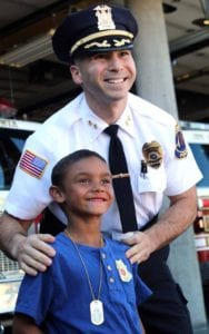 Chief Nayor poses with Amari Champen, the 5-year-old honored for heroism in August. (Ian Austin/AllOTSEGO.conm)