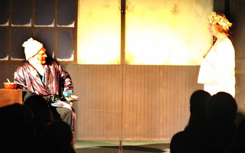 "The Ghost of Christmas Past (Caley Sharratt) advises Ebenezer Scrooge (Michael Henrici) on finding salvation this afternoon at the three-day run of the Glimmer Globe Theatre's ""A Christmas Carol"" wraps up in The Farmers' Museum's Louis Jones Center.  Despite icy roads, the troupe played to a full house.  (AllOTSEGO.com photo)"